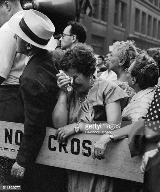 Among a large crowd gathered near Union Square a woman cries during a rally in support for Julius and Ethel Rosenberg New York New York June 19 1953...