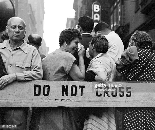 Among a large crowd gathered near Union Square a woman dries her eyes during a rally in support for Julius and Ethel Rosenberg New York New York June...