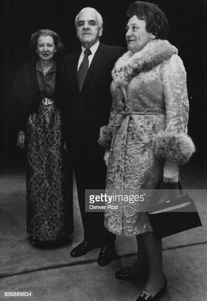 Among FirstNight Crowd Mr and Mrs William McGlone left and Mrs Thomas Jefferson Herbert pause outside Bonfils Theatre before opening curtain of new...