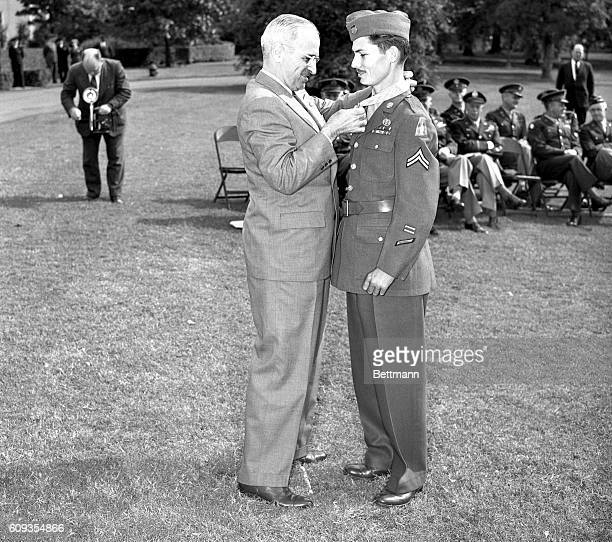 Among the fifteen servicemen awarded the Congressional Medal of Honor at a mass presentation in the White House gardens was Corporal Desmond T Doss...
