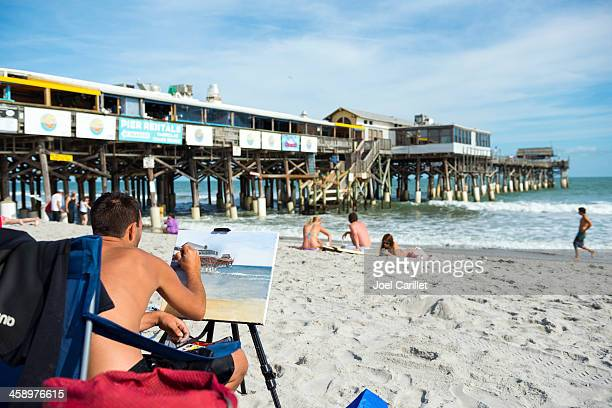 painting the cocoa beach pier - cocoa beach stock pictures, royalty-free photos & images