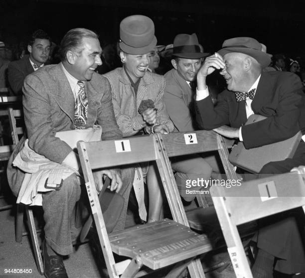 Among the prominent persons who attended the Joe Louis-Billy Conn heavyweight bout at the Yankee Stadium were, left to right: Steve Hannagan, public...