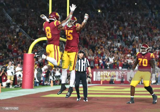 AmonRa St Brown celebrates with USC Drake London after scoring a touchdown during a college football game between the Stanford Cardinal and the USC...