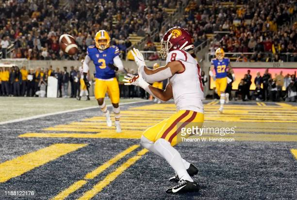AmonRa St Brown of the USC Trojans catches a touchdown pass against the California Golden Bears during the first quarter of an NCAA football game at...