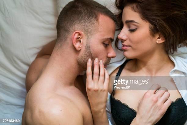 amorous couple touching each other passionately - frau brust erotisch stock-fotos und bilder