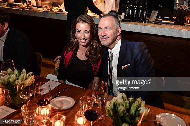 Amoryn Engel and Edward Menicheschi attend the Vanity Fair And Gucci Private Dinner at Gusto 101 on March 27 2014 in Toronto Canada