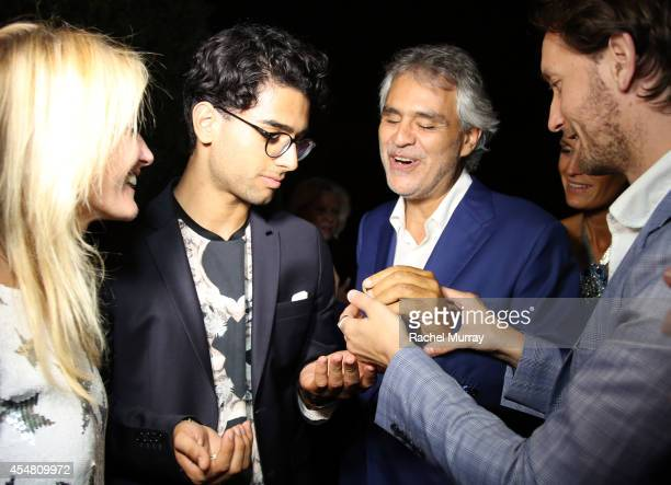 Amos Bocelli and Andrea Bocelli watch the Mentalist Lior Suchard perform during an exclusive dinner held at the Casa Cavalli estate celebrating Fight...