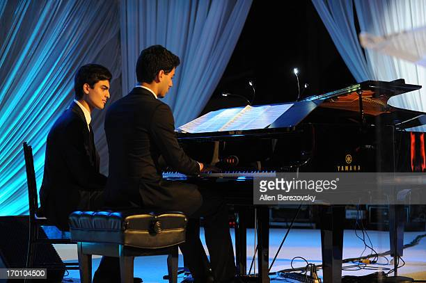 Amos Bocelli and Matteo Bocelli perform during a Celebration of All Fathers' Gala Dinner with Andrea Bocelli at Paramount Studios on June 6 2013 in...