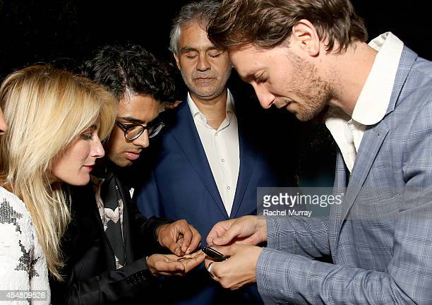 Amos Bocelli, Andrea Bocelli watch the Mentalist Lior Suchard perform during an exclusive dinner at the Casa Cavalli estate celebrating Fight Night...