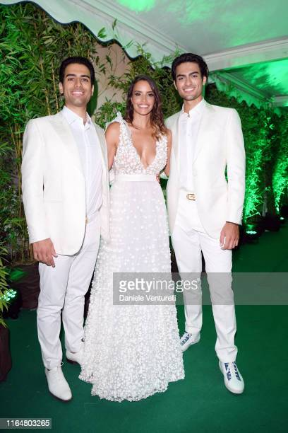Amos Bocelli Rossana Redondo and Matteo Bocelli poses at the Andrea Bocelli Celebrity Fight Night 2019 on July 28 2019 in Forte dei Marmi Italy