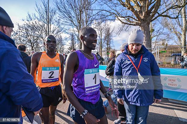 Amos Kipruto on the left and Cyprien Kotut in the middle during Half Marathon on March 6 2016 in Paris France