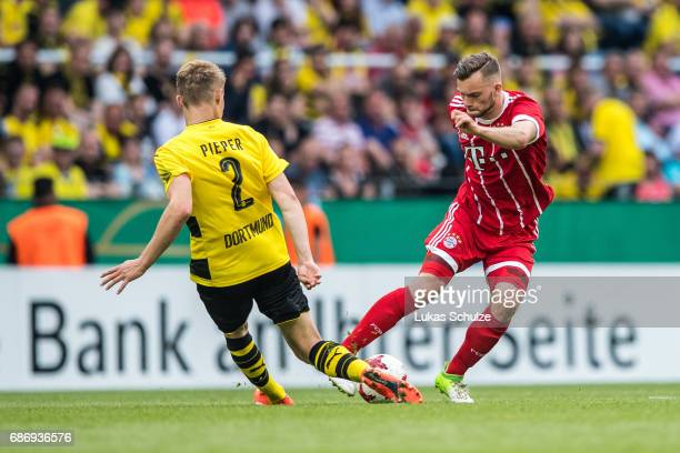 Amos Pieper of Dortmund and Manuel Wintzheimer of Munich fight for the ball during the U19 German Championship Final between Borussia Dortmund and FC...