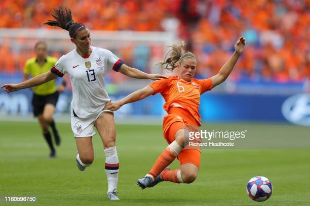 Amouk Dekker of the Netherlands stretches for the ball as she is put under pressure by Alex Morgan of the USA during the 2019 FIFA Women's World Cup...