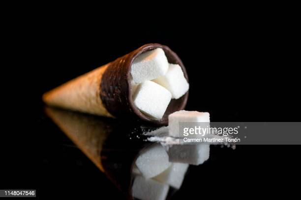amount of sugar that contains an ice cream. - cholesterol test stock photos and pictures
