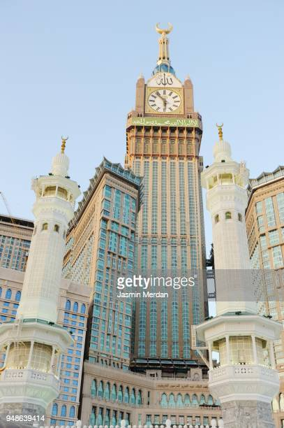 amous clock tower next to mecca grand mosque - clock tower stock pictures, royalty-free photos & images