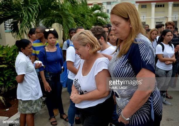 Amparo Font mother of 23yearold Gretell Landrove Font one of the survivors of the plane crash cries after receiving a medical report at the Calixto...