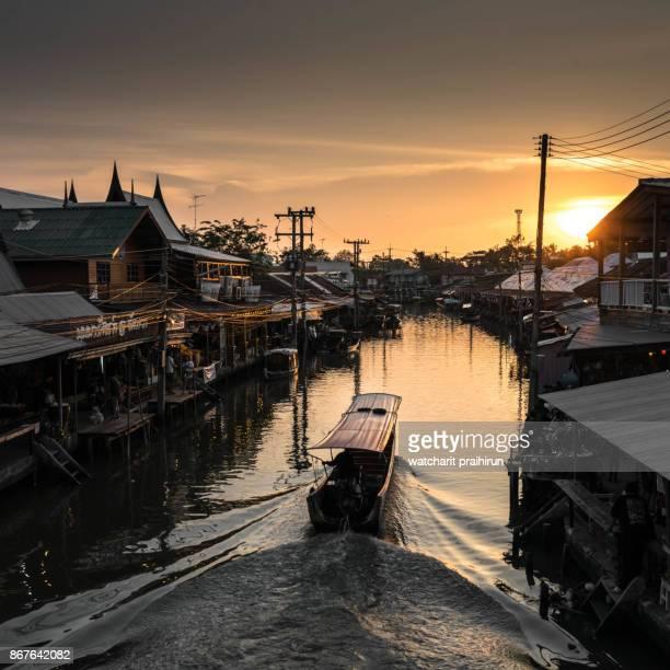 Amphawa floating market at sunset