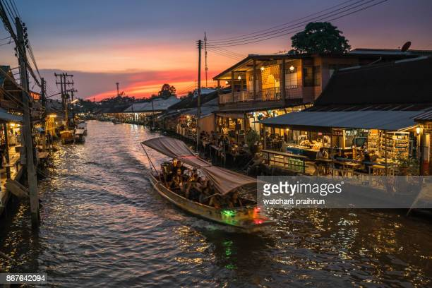 amphawa floating market at sunset - floating market stock pictures, royalty-free photos & images
