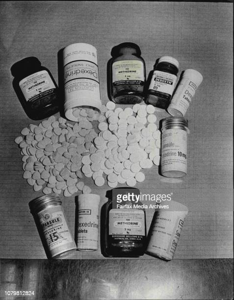 Amphetamine drugs on the chemist's counter the heartshaped tablets at left are yellow and the white tablets at right are Benzadrine amphetamine...