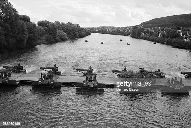 Amphibian vehicles install a bridge over the Danube River during the FrancoGerman military maneuvers nicknamed Moineau Hardi and located in Bavaria