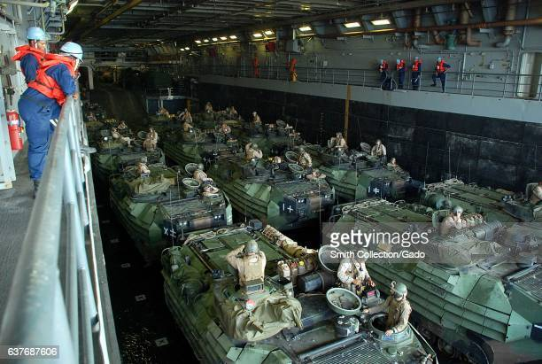 Amphibious Assault Vehicles await departure in the well deck aboard the amphibious transport dock ship USS Green Bay, November 3, 2012. Image...