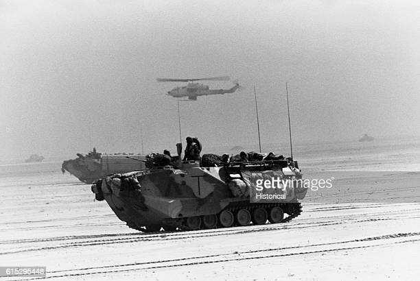 AAV7A1 amphibious assault vehicles of the 1st Combat Engineer Battalion 1st Marine Division advance toward Kuwait City during the third day of the...