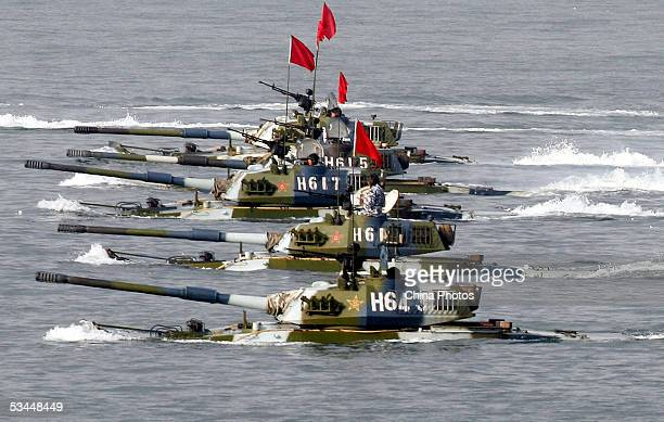 Amphibious tanks of the Chinese People's Liberation Army move to land a beach during the second phase of the SinoRussian joint military exercise on...