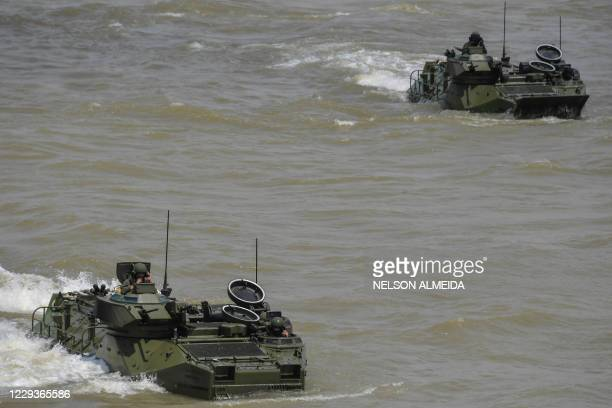 Amphibious vehicles move during a Brazilian Armed Forces military exercise as part of the Agata operation, at Para River in Outeiro, about 30km from...