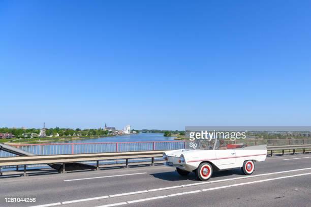 "amphicar model 770 amphibious automobile  driving on a bridge over the river ijssel - ""sjoerd van der wal"" or ""sjo"" stock pictures, royalty-free photos & images"