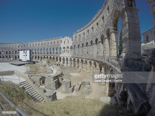 amphitheater against blue sky on sunny day - lingard stock photos and pictures