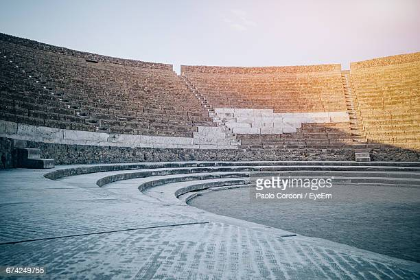 amphitheater at pompeii against sky - amphitheatre stock photos and pictures