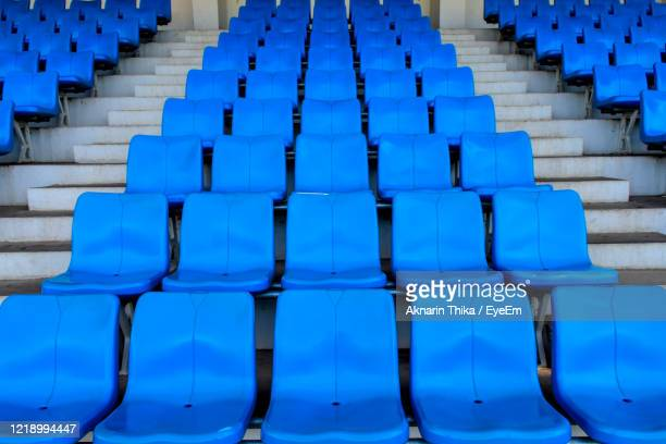 amphitheater. plastic seat rows at the arena. - bleachers stock pictures, royalty-free photos & images