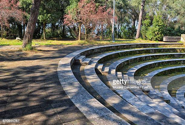 amphitheater steps at park - amphitheater stock photos and pictures