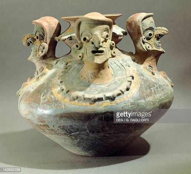 Amphora decorated with three human heads originating from Bahia Ecuador PreColombian Civilization 5th Century BC5th Century AD Quito Museo Del Banco...