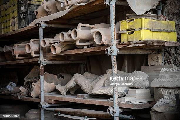 Amphorae and the cast of a body found in the excavations are stored inside a storage area at the archaeological site waiting to be assigned to the...