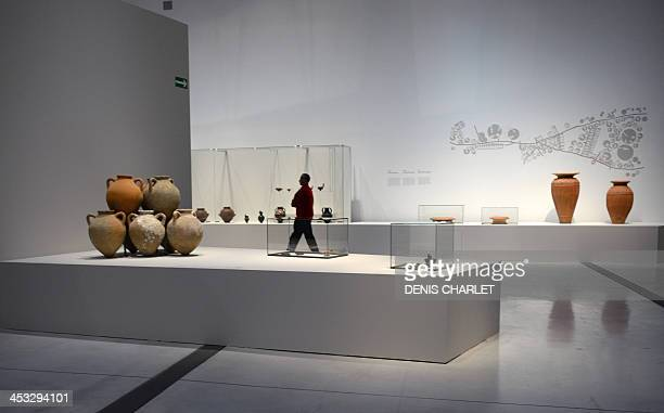 Amphoras are displayed on December 3 2013 at the Louvre Lens museum as part of the exhibition 'The etruscans and the mediterranean' which presents...