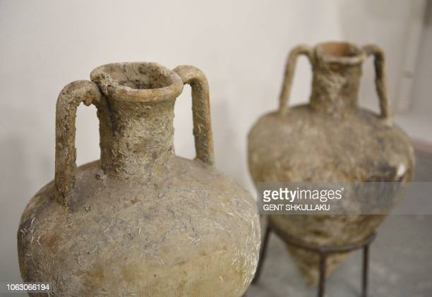 Amphoras from the 4th century BC and found underwater in Butrint are displayed at Albania's National Archeological Museum in Tirana on September 24...