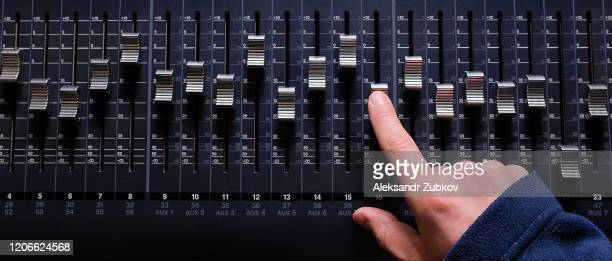 amplifying equipment that adjusts studio audio mixer knobs and faders. workplace and equipment of the sound engineer. acoustic mixing of music, selective focus. banner. - equaliser stock pictures, royalty-free photos & images