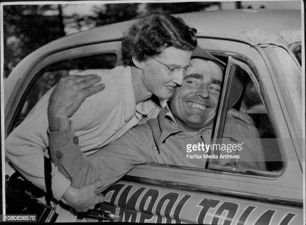 Ampol Trial Finish Probable Ampol winner Wilf Murrell is greeted by his wife on arrival at Bondi July 29 1956