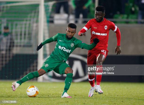 Ampomah of Antwerp competes against Cicinho of Ludogorets during the UEFA Europa League Group J stage match between PFC Ludogorets Razgrad and Royal...