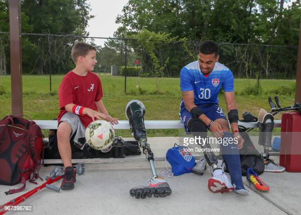 Amputee Andrew Cooper and Team USA Jovan Booker chat during the Lone Star Invitational Amputee Soccer tournament on June 2 2018 at Gosling Sports...