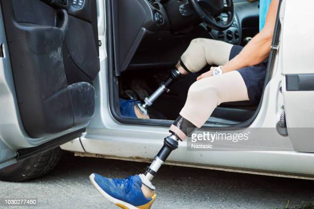 amputee car driver - assistive technology stock photos and pictures