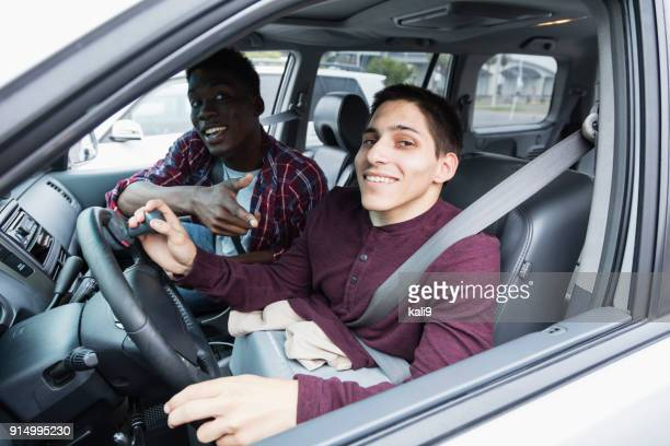 amputee driving specially equipped car, with friend - persons with disabilities stock pictures, royalty-free photos & images