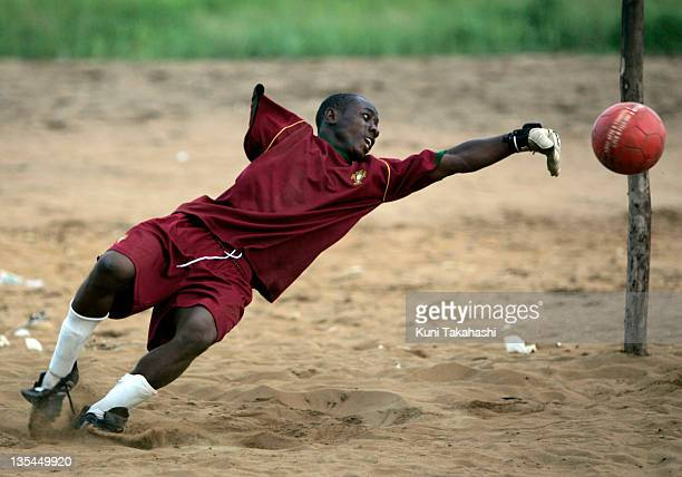 Amputee football goalkeeper Joseph Allen practices on the field May 2 2008 in Monrovia Liberia Although the Liberian National team won the 2008 All...