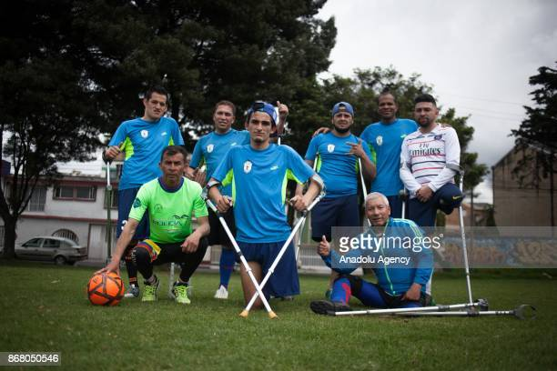 Amputee soccer players from Colombia are seen as they pose for a photo during training period at the Public sports grounds in Bogota Colombia on...