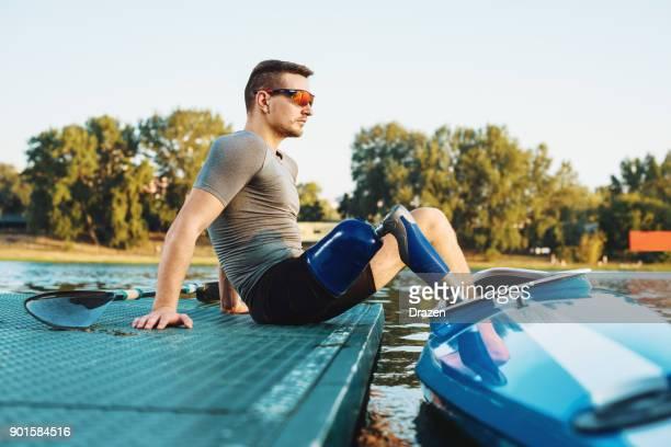 Amputee sportsman focusing before kayaking training