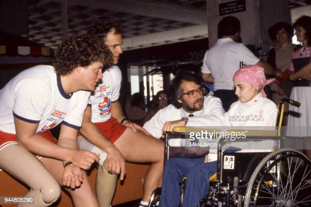 Amputee Ted Kennedy Jr and amputee Jeff Keith raise money for American Cancer Society in Jeff Keith's Run Across America They also visit hospitalized...