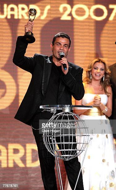 Amr Diab accepts the award for Best Selling Middle Eastern Artist from Razan on stage at the World Music Awards 2007 at the Monte Carlo Sporting Club...