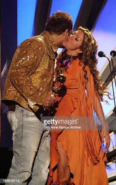 Amr Diab kisses Razan El Moghrabi during World Music Awards 2002 Show at Monte Carlo Sporting Club in MonteCarlo Monaco