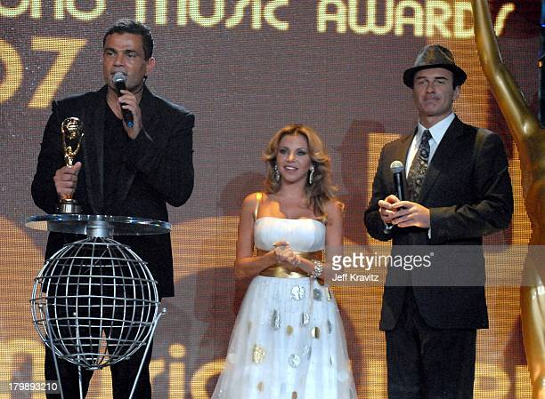Amr Diab with the award for Best Selling Middle Eastern Artist on stage with Razan and host Julian McMahon during the 2007 World Music Awards held at...